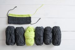 Knitting yarn with knitting pattern on white wooden background. The concept of Hobbies, crafts, the beginning of a new knitting pr. Oject stock images