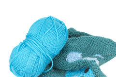 Knitting yarn and piece of sweater isolated Royalty Free Stock Photography