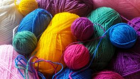 Knitting yarn in rainbow colors. Wool yarn background in vibrant rainbow colors Stock Photography