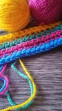 Knitting yarn in rainbow colors. Wool yarn in rainbow colors on a dark wooden background Stock Photo