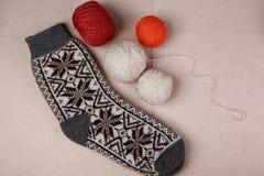 Knitting yarn and socks. Knitting yarn and ready socks royalty free stock image