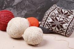 Knitting yarn and socks. Knitting yarn and ready socks stock image