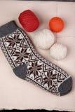 Knitting yarn and socks. Knitting yarn and ready socks royalty free stock photography