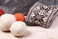 Knitting yarn and socks. Knitting yarn and ready socks stock images