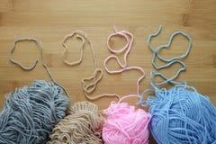 Knitting yarn on wooden table Stock Photos