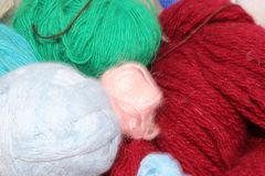 Yarns. Knitting yarns bokeh Royalty Free Stock Photo