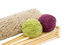 Knitting yarns and needles. Knitting wool yarns and needles isolated over white background. This image is exclusive to Dreamstime Royalty Free Stock Images