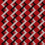 Knitting zigzag seamless pattern in red and white colors Royalty Free Stock Photo