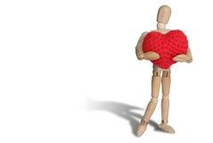 Knittingt för hjärta för Wood dvärgkram röd på vit backgroun royaltyfria foton
