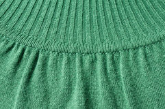 Knitwear detail of green turtleneck jersey. Close up and detail of green turtelneck pullover, knitting pattern and stiches Stock Photography