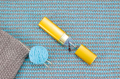 Knitwear and knitting needles Royalty Free Stock Photography
