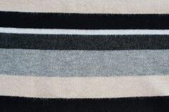 Knitwear striped in grey, black, beige, white Royalty Free Stock Photos