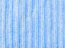 Knitwear texture blue background. Blue knitwear sweater wool texture background macro closeup Royalty Free Stock Photography