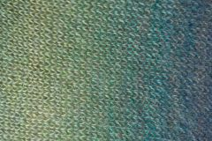 Knitwork in shades of green and blue. From above stock photo
