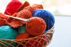 Knitwork tools and thread balls in a basket. Knitwork colourful tools and thread balls in a basket Royalty Free Stock Photo