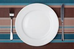 Kniv, gaffel och platta Fotografering för Bildbyråer