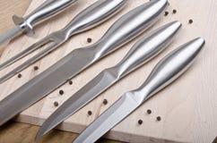 Knivar med peppar Royaltyfria Bilder