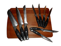 Knivar på en skärbräda som isoleras på vit Royaltyfri Bild