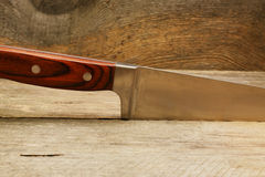 Knive on a wooden surface. Kitchen knive on a wooden surface close up Royalty Free Stock Images