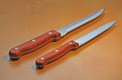 Knives. Two new sharp kitchen knives Royalty Free Stock Photo