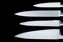 Knives. Knife blades on black Stock Photos