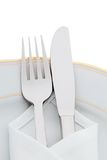 Knives, forks and plates Stock Image