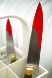 Knives with fresh blood in a dishwasher. Vertical format stock images