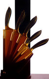 Knives in golden sheathes Stock Images