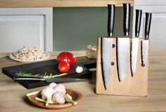 Knives on  magnetic rack standing a table Royalty Free Stock Photo