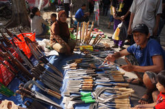 Knives and swords. Merchants selling knives and swords at a market in the city of Solo, Central Java, Indonesia Stock Image