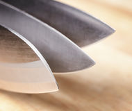 Knives on wooden board Royalty Free Stock Images