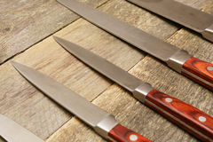 Knives on a wooden surface Stock Photo