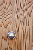 The knob. Knob on a wooden door Stock Image