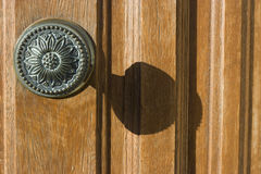 Knob. Old knob on a wooden door Royalty Free Stock Images
