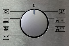 Knob. A silver knob of a oven taken with macro lens Royalty Free Stock Photo