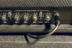 Knob control and jack connector of  amplifier background. Royalty Free Stock Images