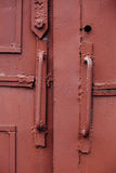 Knob, handle A fragment of an old red iron door, the Soviet Russ Royalty Free Stock Photography