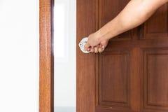 Knob locks. Hand open door by Knob locks on the door stock image