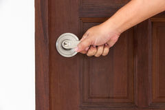 Knob locks. Hand open door by Knob locks on the door Royalty Free Stock Images