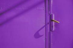 Metalic Door Knob. Metalic violet door with golden knob Royalty Free Stock Photo