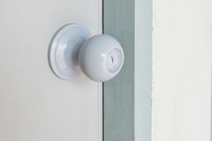 Knob on an old white door Stock Photos