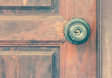 Knob on old wooden door,vintage effect filter Stock Photography