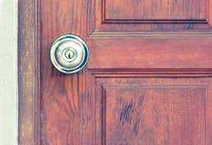 Knob on old wooden door,vintage effect filter Stock Photo