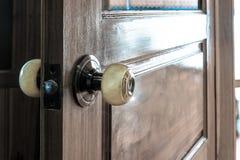 Knob on old wooden door,vintage effect filter Stock Images
