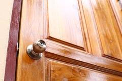 Knob on wooden door Stock Photography