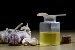 Knoblauch das beste Besondere für Grippe Der Sirup, der aus zugebereitet wird, heilen Stockfotos