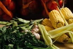 Knoblauch und Petersilie und Mais Lizenzfreies Stockfoto