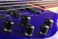 Knobs. A technical look at a bass guitar Royalty Free Stock Image