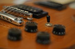 Knobs and buttons - Closeup shot of Washburn Idol WI-64 electric guitar with Tune-o-matic bridge stock photo