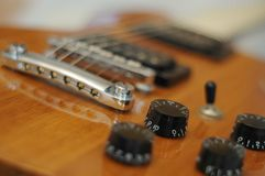 Knobs and buttons - Closeup shot of Washburn Idol WI-64 electric guitar with Tune-o-matic bridge stock photos
